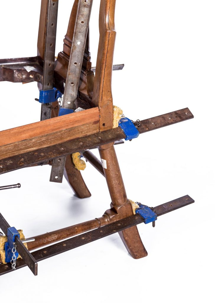 Chair in clamps