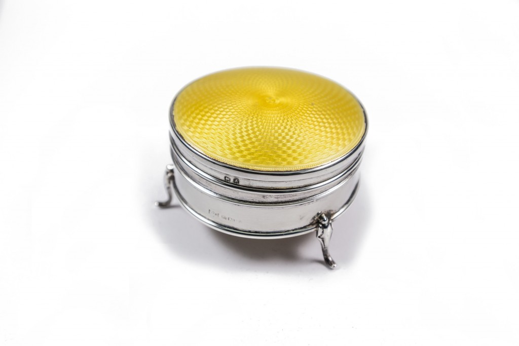 Silver compact with yellow enamel