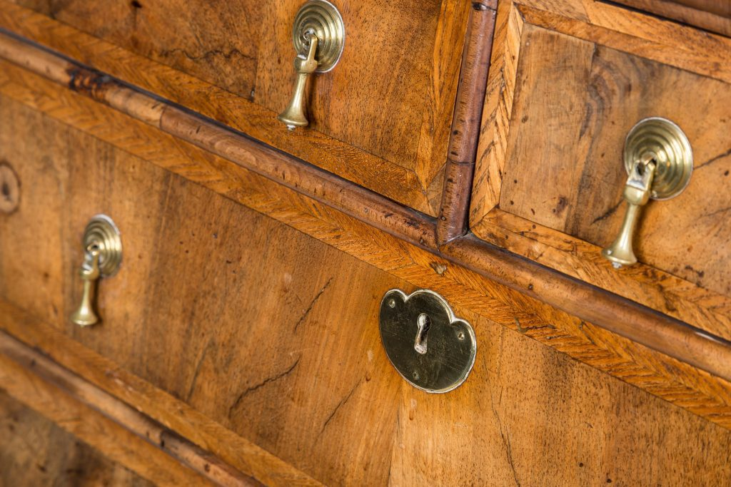 English walnut drawers showing brass detail