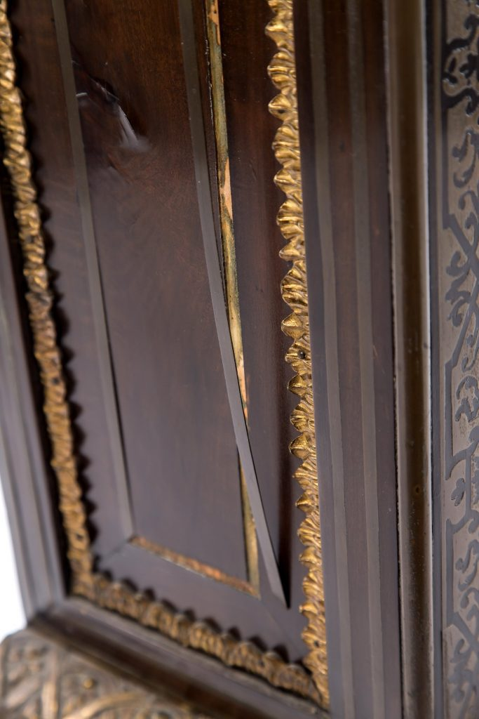 Brass stringing requiring lifting and relaying with traditional adhesives