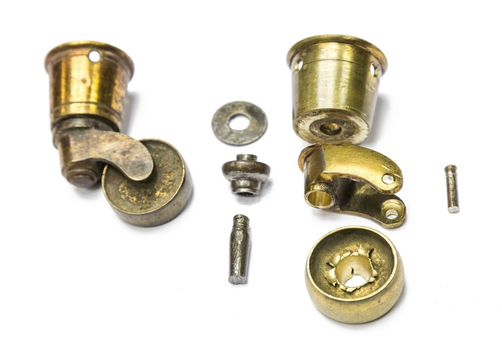 Brass cup caster from dining chair