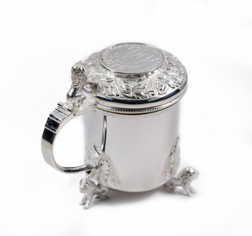 Silver pot with clear glass liner
