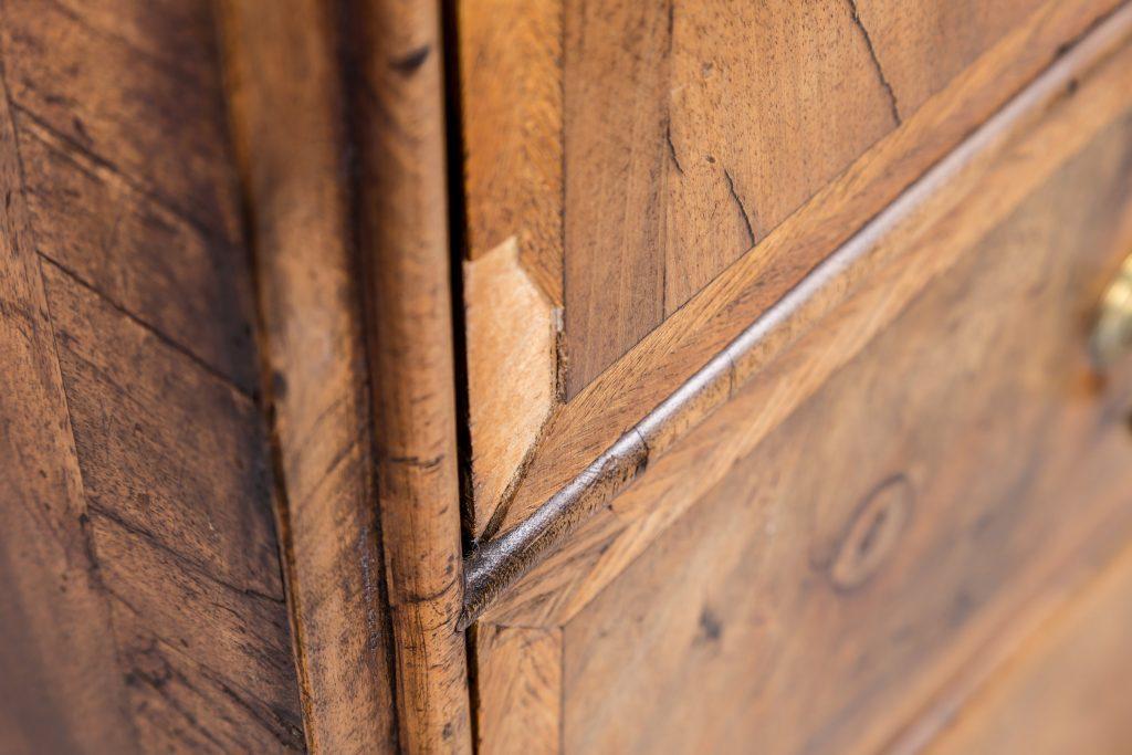 Section of walnut veneer missing