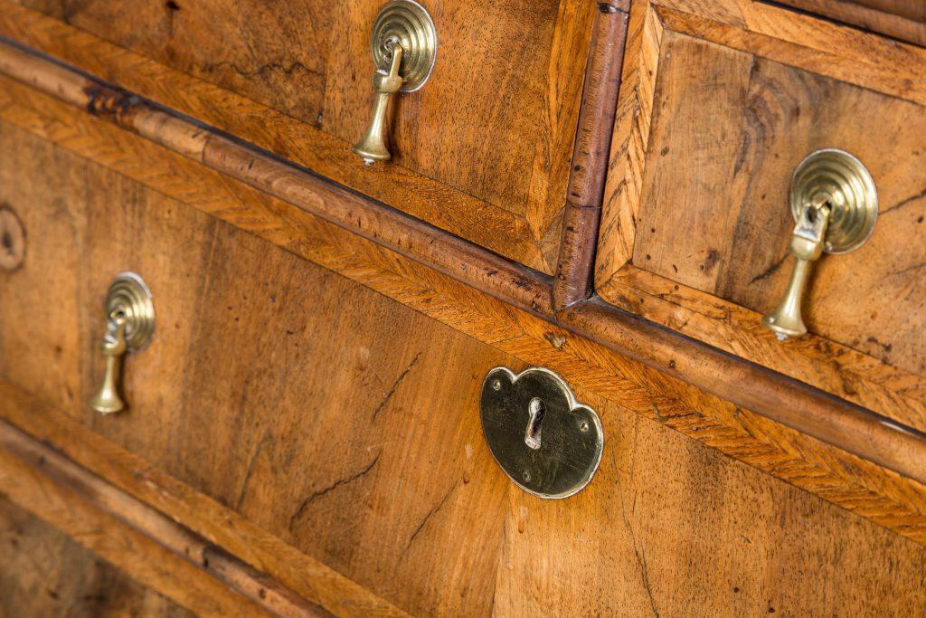 English walnut drawers showing brass detail