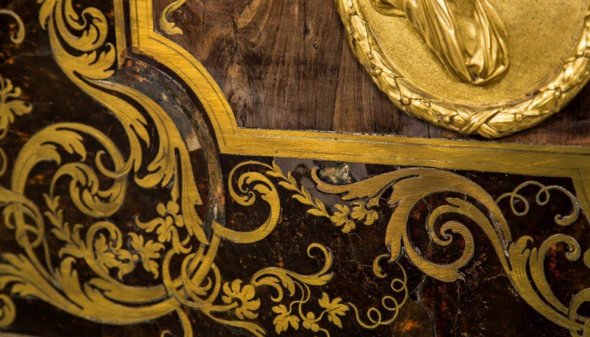 Boulle detail showing missing brass pieces and shell loss