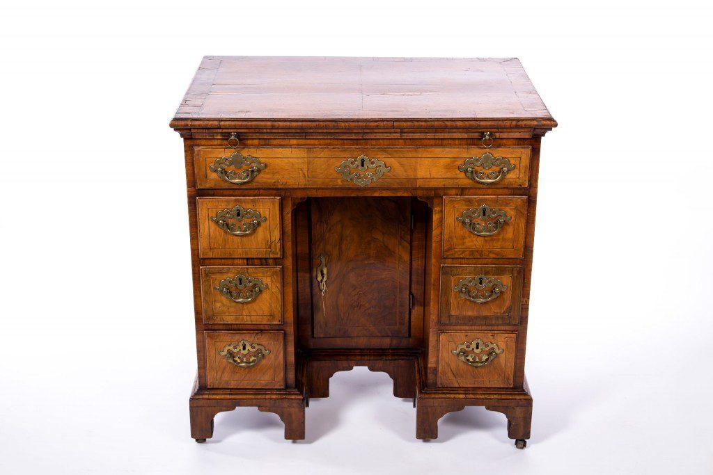 Front elevation of walnut knee-hole desk